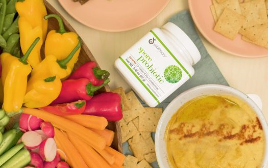 Spore Probiotic powder bottle next to Roasted Squash Dip